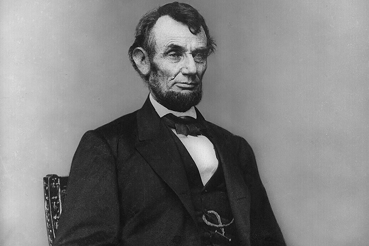 Abraham_Lincoln_seated_Feb_9_18641
