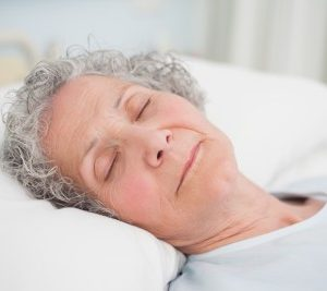 elderly senior citizen woman sleeping well and happily
