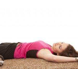 woman with weights exercising for weight loss, something that sleep can help your genes with