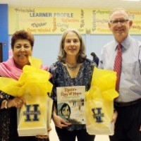 Source: The Leader News, Harvard Elementary Principal Kevin Beringer with Raiza Jan (left) and Elizabeth Suneby (center)