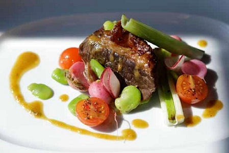 Source: The Points Guy, Slow roasted brisket with fava beans and breakfast radish
