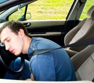 man asleep driving