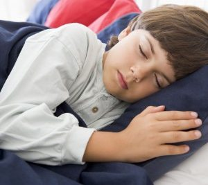 Kid sleeping stays fit and healthy because not sleeping enough can lead to child becoming heaving and gaining weight.
